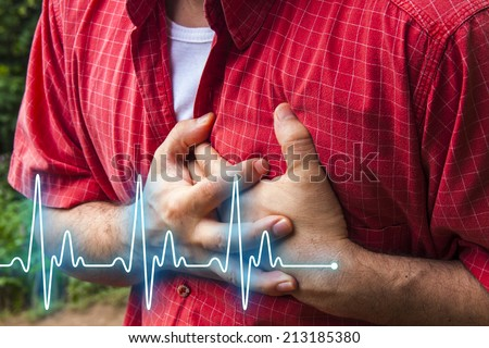 Men in red shirt having chest pain - heart attack - heartbeat line - stock photo