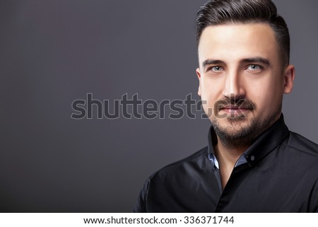 Men in shirt on grey background in studio photos