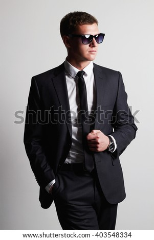 Men in suit. confident young businessman in sunglasses. handsome man - stock photo