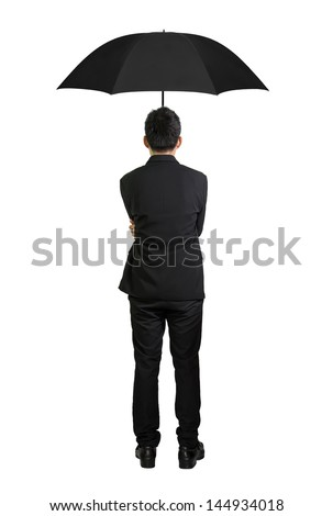 Men in suit stand  holding black umbrella on isolate white back ground - stock photo