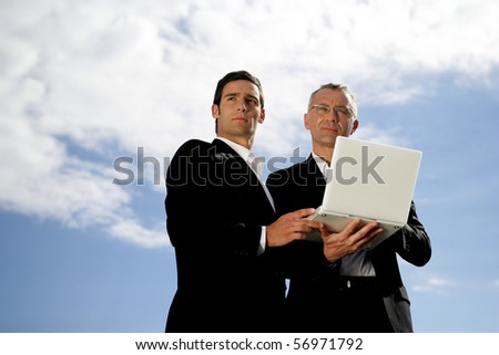 Men in suit with a laptop computer - stock photo
