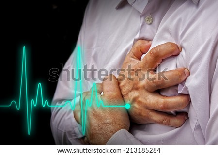 Men in white shirt having chest pain - heart attack - heartbeat line - stock photo