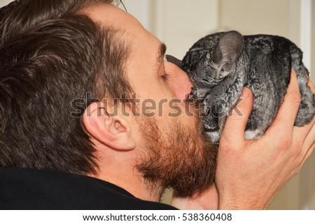 Men kissing gray chinchilla