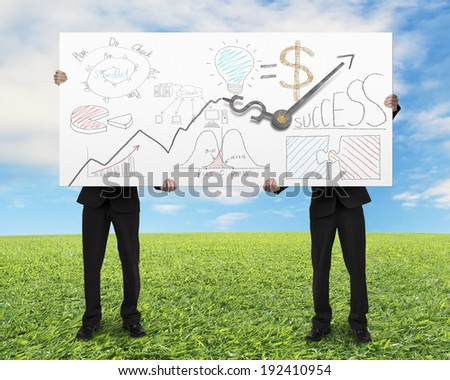 Men lifting board with money symbol clock hands and doodles meadow and blue sky background - stock photo