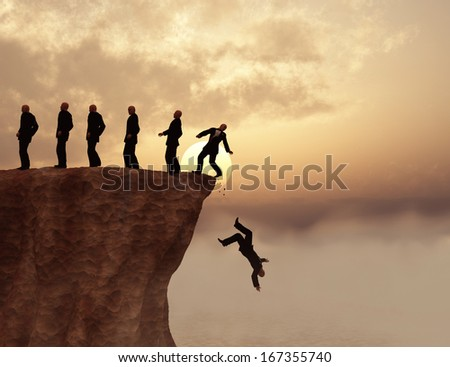 Men on a cliff - stock photo