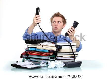 Men overwhelmed at work - stock photo