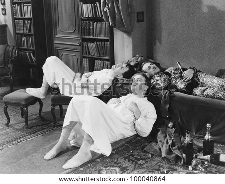 Men passed out with champagne bottles - stock photo