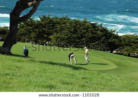 Men playing golf at an ocean golf course