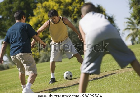 Men Playing Soccer - stock photo