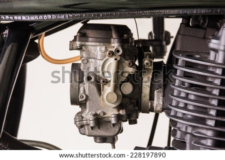 men repair a caburator motorcycle - stock photo