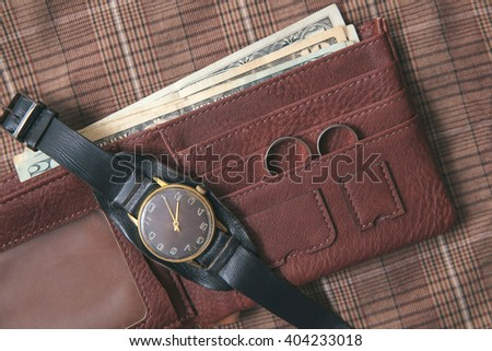 Men's accessories - clock, wedding rings, purse on textile background. - stock photo