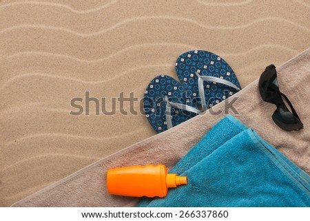 Men's accessories for the beach lying on the sand, with place for your tex - stock photo
