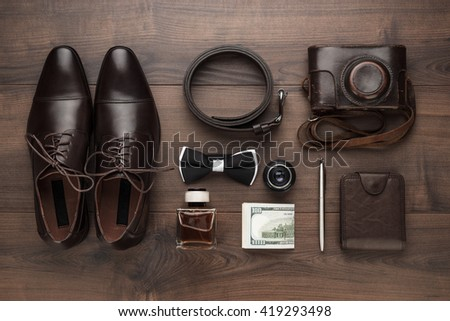 men's accessories in order on the brown wooden table overhead view - stock photo