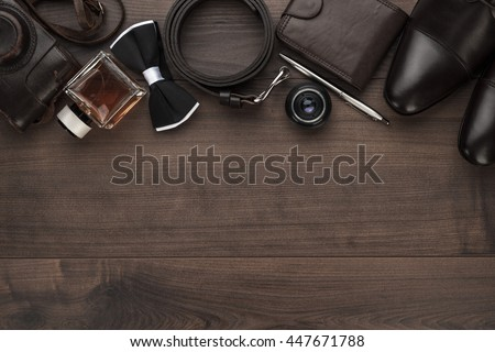 men's accessories in order on the brown wooden table overhead view with copy space - stock photo