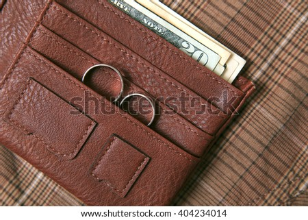 Men's accessories -  leather purse on textile background. - stock photo