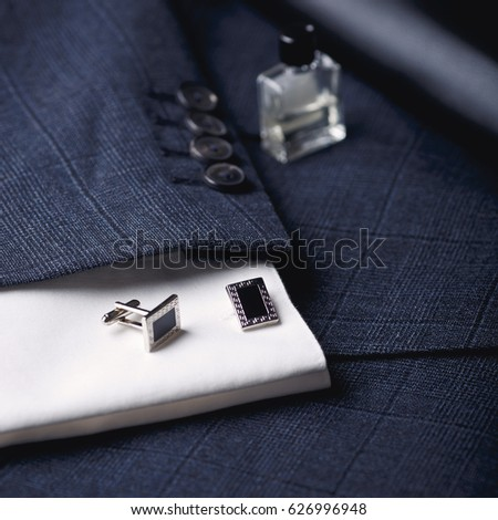 Men's accessories - smartphone, cufflinks, shirt, pen, jacket.