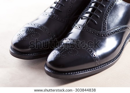 Men's Black Semi-Brogue Laced Oxfords Shoes. Diagonal Composition. Horizontal Image - stock photo