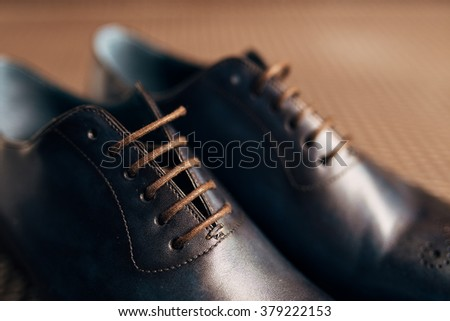 Men's black shoes on the floor