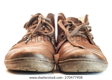 Men's brown leather shoes isolated on white background. Dirty, worn-out boots - stock photo