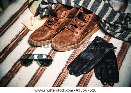 Men's brown shoes on a vintage wooden background a