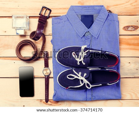 Men's casual clothes on wooden background - stock photo
