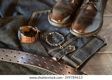 men's casual fashion apparel and accessories - jeans and belt, leather shoes, wrist watch, bracelet on hand