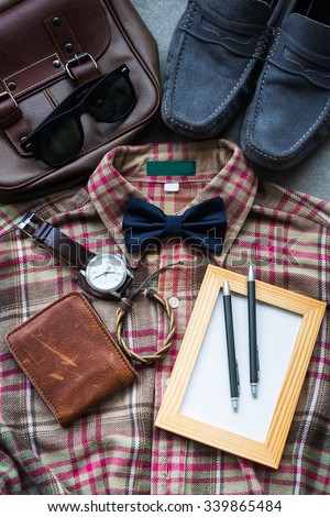 Men's casual outfits background, brown plaid shirt, bow tie, blue shoes, brown bag and accessories - stock photo