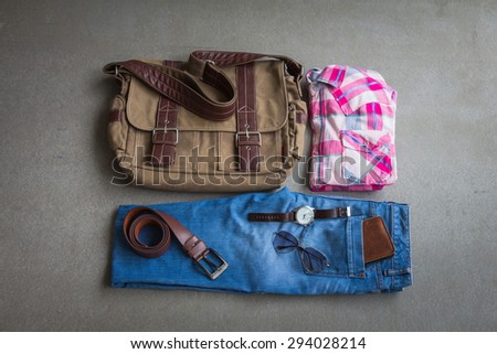 Men's casual outfits on gray background - stock photo