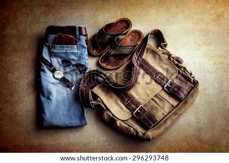 Men's casual outfits on grunge background - stock photo