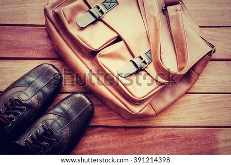 Men's casual outfits with leather accessories on wooden background - stock photo