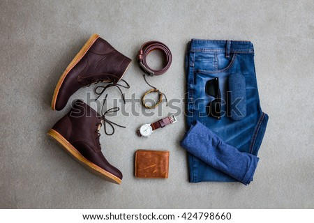 Men's casual outfits with man clothing and accessories on gray grunge background