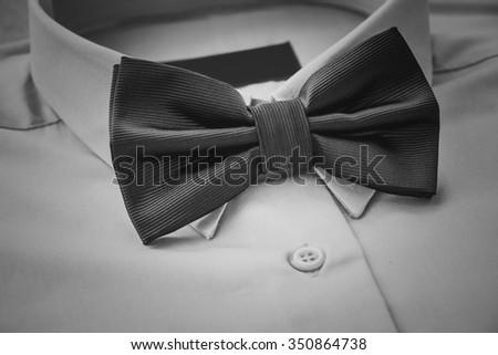 Men's casual outfits with shirt and bow tie, selective focus, black and white