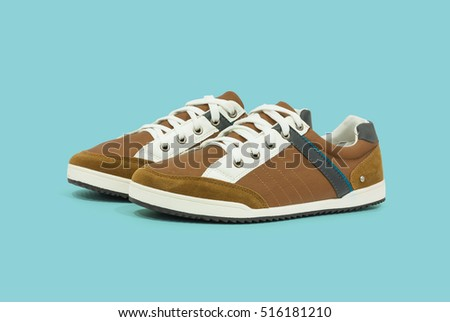 Men's casual shoes on plain background