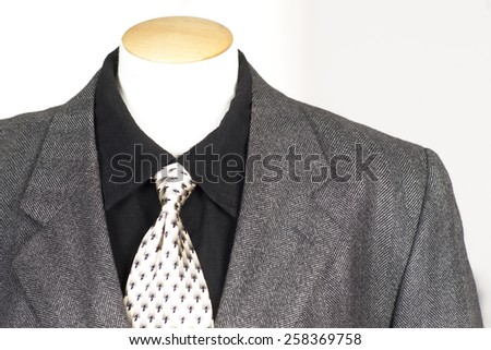 Men's clothing store formal wear display shirt tie jacket - stock photo