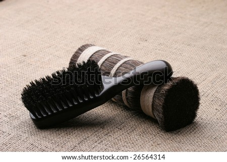 Men's comb. Expensive wooden comb lying on the cloth.