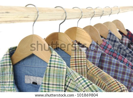 Men's different colors short sleeved plaid cotton on a wooden hanger - stock photo