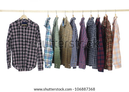 Men's different colors sleeved plaid cotton on a wooden hanger - stock photo