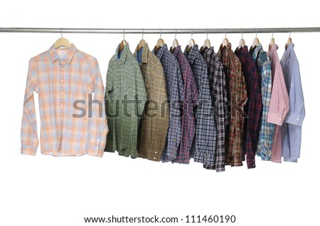 Men's different sleeved plaid cotton on a hanger - stock photo