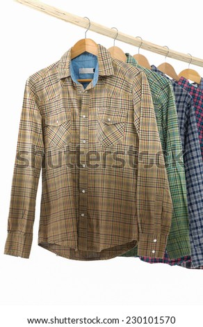 Men's different sleeved plaid cotton on wooden hanger - stock photo