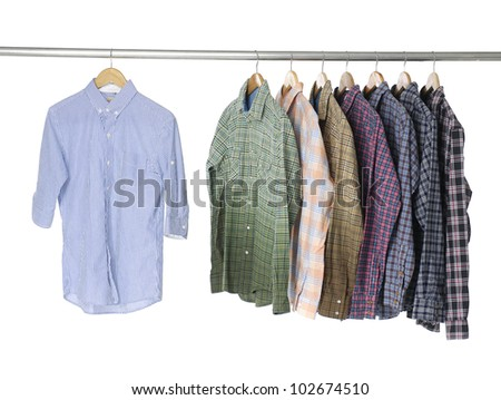 Men's different sleeved plaid cotton shirt with on hanger - stock photo