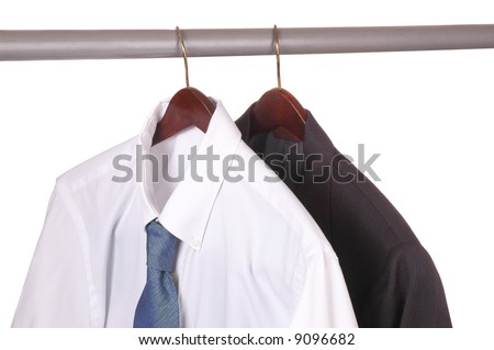 Men's Dress Shirt and Suit on Hanger in closet isolated over white
