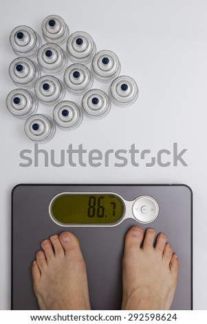 Men's feet on floor scales and medical cans for vacuum massage. - stock photo
