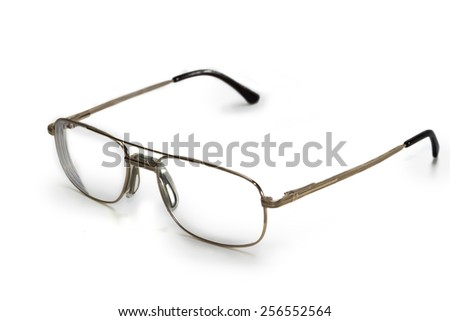 Men's glasses in the thin rim of yellow color on a light background - stock photo