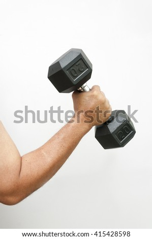 Men's hand holding dumbbell. Close up, concept of healthy lifestyle.