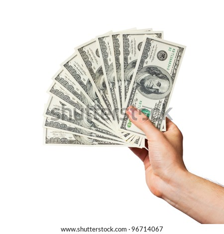 Men's hand holds a fan of dollars on white background