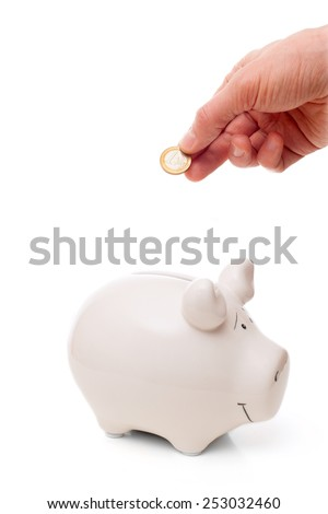 men's hand putting coin in piggy Bank  - stock photo
