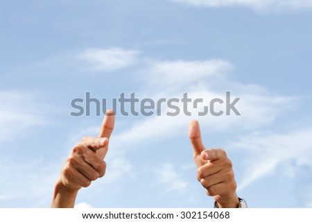 men's hand shows the sign that everything is fine, everything is very good. Space for text. Left, right. Concept about the good things and the good news.  - stock photo
