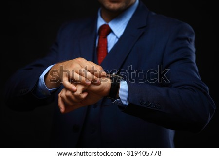men's hand with a watch. - stock photo