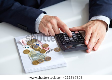 Men's hands with calculator. Calculation at office  - stock photo
