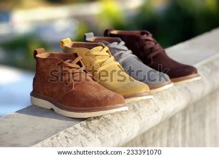Men's high-top leather shoes on a Outdoor background  - stock photo